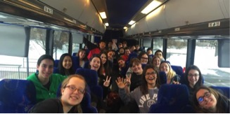 Students on the bus on their way to Disney!