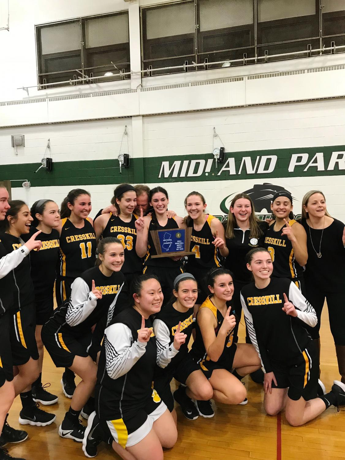 The 2017-2018 Girls Basketball team after their victory at Midland Park