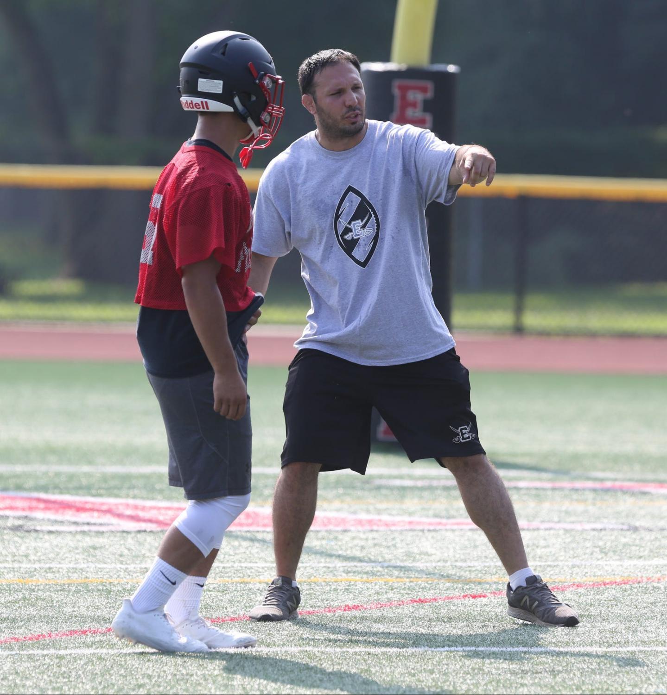 Coach Calandrino on the football field.