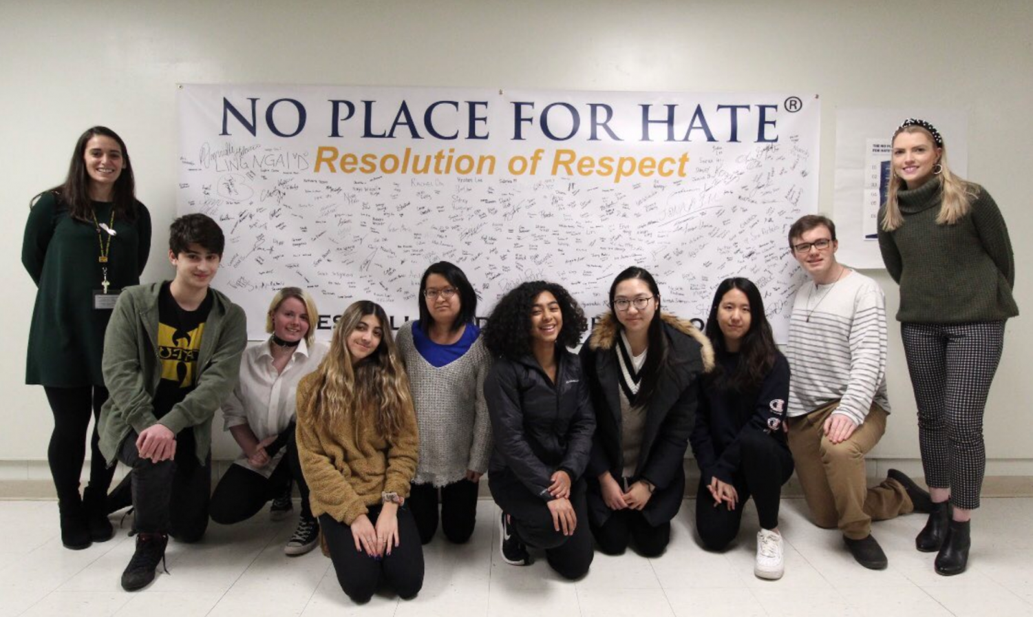 Mrs. McCarthy, Ms. Lynch, and student members of the No Place for Hate Committee pose with Cresskill's Resolution of Respect Pledge.