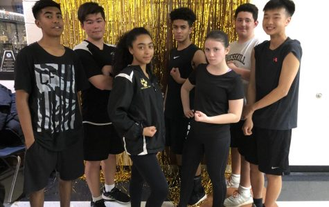 Last year's winning team, from left to right: Marcus Pardasie, Chris Raymond, Keyla Hiciano, Marcus Ray, Ms. Taliento, Vincent Cristantiello, and Jeffrey Kwon