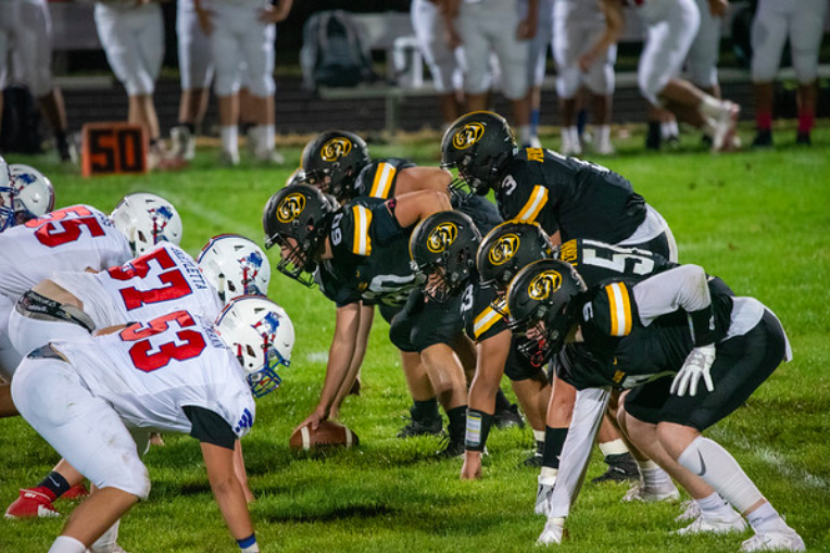 The+Cougars+line+up+against+the+Patriots+on+Friday+night.+Photo+Courtesy+of+Isora+Abreu.