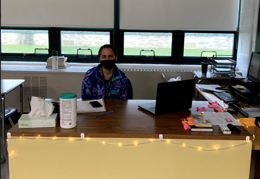 Ms. Sandoval at her new desk in C13